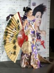 Miss Japan 2010 Maiko Itai poses for photographers in her national costume at the Mandalay Bay Resort and Casino in Las Vegas, Nevada